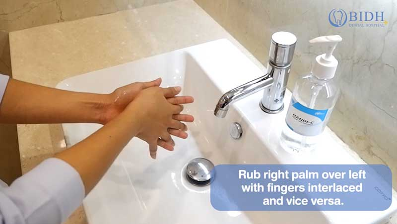 Rub right palm over left with fingers interlaced and vice versa